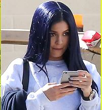Kylie Jenner checking the news on her smart phone. Photo credit - JustJared
