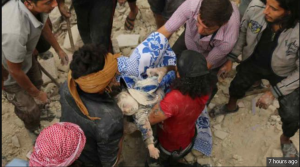 A child is pulled from the rubble of recent warplane bombings in Aleppo, Syria. Source: Reuters